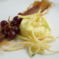 Parmesan Flan Savory Flan Served with Pickled Grapes and Crispy Leeks