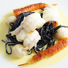 Lobster Tail, House-Made Squid Ink Pasta Served with a Saffron Cream and Roasted Baby Turnips.