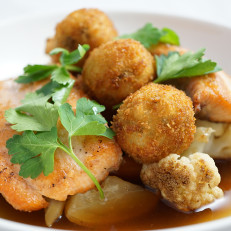 Seared Salmon Finished with Fresh Herbs, Wild Mushroom Broth, Served with Roasted Root Vegetables and Arancini